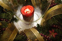 Green christmas wreath with red candle Royalty Free Stock Photos