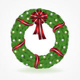 Green Christmas Wreath with Ribbon and Bow Stock Image