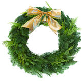 Green christmas wreath woth golden bow royalty free stock image