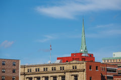 Green Church Steeple Over Canadian City Royalty Free Stock Image