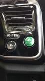 Green circle button controller of economy fuel of hi-tech car Stock Photo