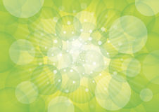 Green circles and light. Green circles on white rays of light and bluish background Royalty Free Stock Photography