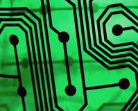 Green circuit board. Abstract circuitry on green pcb board with glowing back lighting Stock Image