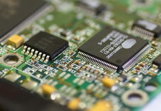 Green circuit board with components Royalty Free Stock Photos