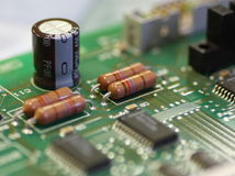 Green circuit board with components Stock Photos