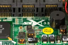 Green circuit board with conductor tracks, elements and electron stock image