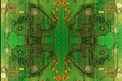 Circuit board abstract. Green circuit board of a modern computer IT component - abstract butterfly Stock Photography