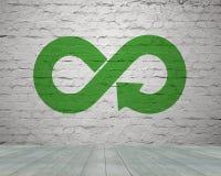 Green circular economy concept. Arrow infinity symbol with grass on brick wall royalty free stock photo