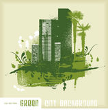 Green city background. Cityscape with grunge and floral elements - copyspace for your text Stock Photos