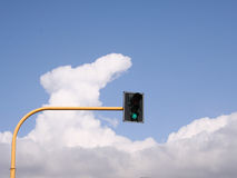 Green city light. Green light with sky and clouds in background Stock Images