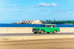 Green classic American car on street of Havana Royalty Free Stock Images