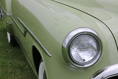 Green Classic Car. Headlight and right front fender of green classic Pontiac Catalina at car show Royalty Free Stock Images
