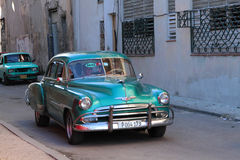 Green classic old American car in Cuba Royalty Free Stock Photo