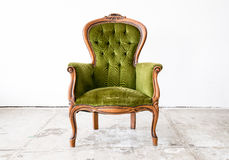 Green classical style Armchair sofa couch in vintage room Royalty Free Stock Images