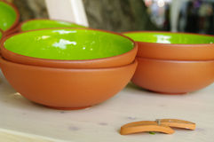 Green clay pottery plates at the fair of artisans in Riga Stock Image