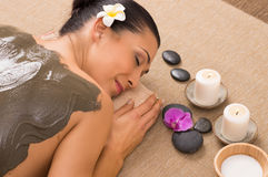 Green Clay Treatment At Spa. Relaxed Woman Receiving A Mud Treatment At Spa Stock Photo