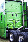 Green clean new model rig semi truck rig back view Stock Photo