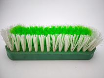 Green cleaning brush isolated with white background stock image