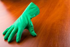 Green cleaning glove Royalty Free Stock Photo