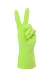 Green cleaning glove, victory sign Royalty Free Stock Image