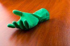 Green cleaning glove Stock Photography