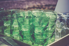 Green clear glasses stacks on the table in a cafe Stock Photos