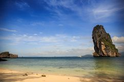 Green cliff in blue sea. Tropical green cliff stand in blue sea Royalty Free Stock Photo