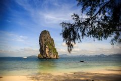Green cliff in blue sea. Tropical green cliff stand in blue sea Stock Photos