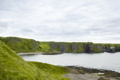 Green cliffs in Stonehaven Royalty Free Stock Photography