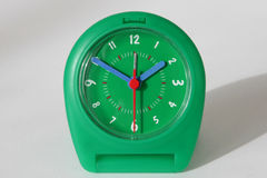 Green Clock. You see a little green travel alarm clock Royalty Free Stock Image