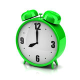 Green clock alarm Stock Images