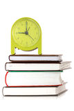 Green clock and  books Stock Photos
