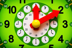 Green clock display with red arrows closeup Royalty Free Stock Photography
