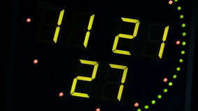 Green clock with an electronic scoreboard. Studio Green clock with an electronic scoreboard stock footage