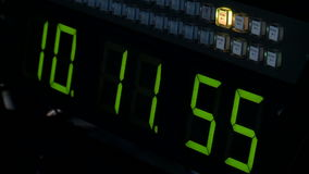 Green clock with an electronic scoreboard. Studio Green clock with an electronic scoreboard stock video footage