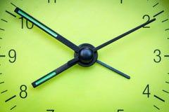 Green clock face. Closeup of hands on green clock face stock images