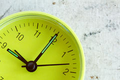 Green clock face over a dirty background Stock Image