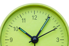 Green clock face over a white background Stock Photo