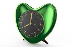 Green clock in the shape of heart Royalty Free Stock Image