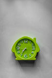 Green clock. A shot of a green clock showing 0735 in the morning Stock Photos
