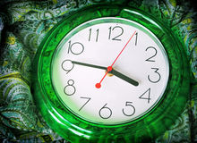 Green clock Stock Images