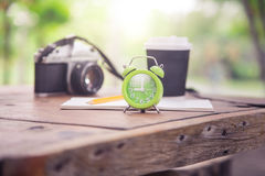 Green clock and stationery stock image
