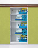 Green closet. Open closet with stacks of blue home accessories on shelves royalty free stock photo