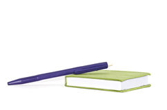 Green cloth cover book  and pen Royalty Free Stock Images