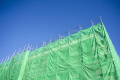 Green cloth cover on building Royalty Free Stock Photo