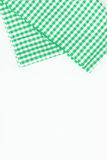 Green cloth, a kitchen towel with a checkered pattern, on a whit Stock Photo