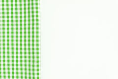 Green cloth, a kitchen towel with a checkered pattern, on a whit Stock Photos