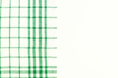 Green cloth, a kitchen towel with a checkered pattern, on a whit Royalty Free Stock Images