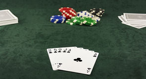 On the green cloth lying Center pot and poker hand of five cards Royalty Free Stock Images