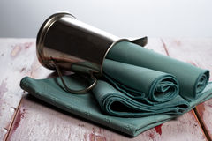 Green cloth napkins. On a worn wood surface Stock Photography